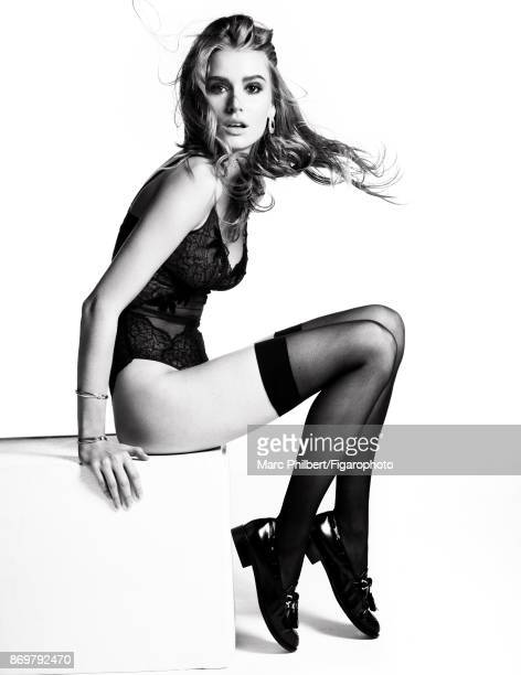 Model Elise Pluvinage poses at a fashion shoot for Madame Figaro on September 19 2017 in Paris France Body earring bracelets stockings shoes...
