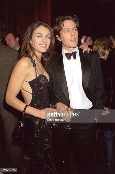 Model Elizabeth Hurley and actor Hugh Grant at the US Vogue party held during London Fashion Week on February 23 1999 in London