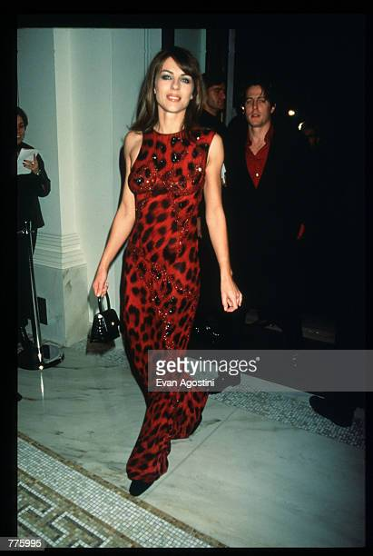 Model Elizabeth Hurley attends the grand opening of a new Versace Boutique on 5th Avenue October 26 1996 in New York City Gianni and Donatella...