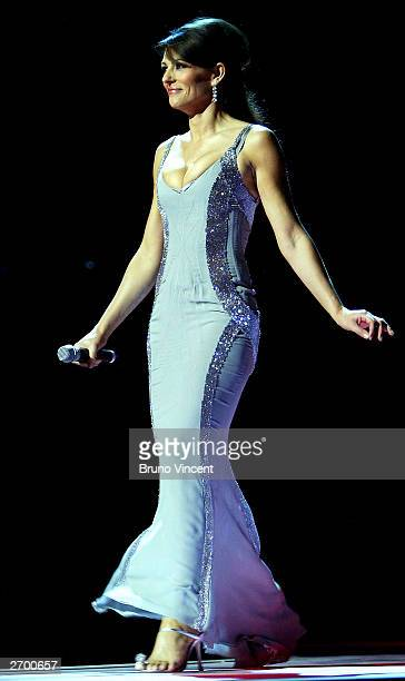 Model Elizabeth Hurley is seen hosting Fashion Rocks for the Princes Trust at the Royal Albert Hall October 15 2003 in London The event combined...