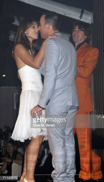 Model Elizabeth Hurley kisses producer David Furnish after accepting the award for Entrepreneur of the Year as TV presenter Jonathan Ross looks on...