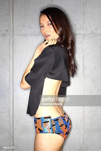 Model Ella Verbene prepares backstage ahead of the Suboo show during MercedesBenz Fashion Week Australia Spring/Summer 2013/14 at Carriageworks on...
