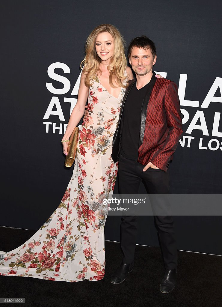 Model Elle Evans (L) and musician Matt Bellamy attend the Saint Laurent show at The Hollywood Palladium on February 10, 2016 in Los Angeles, California.