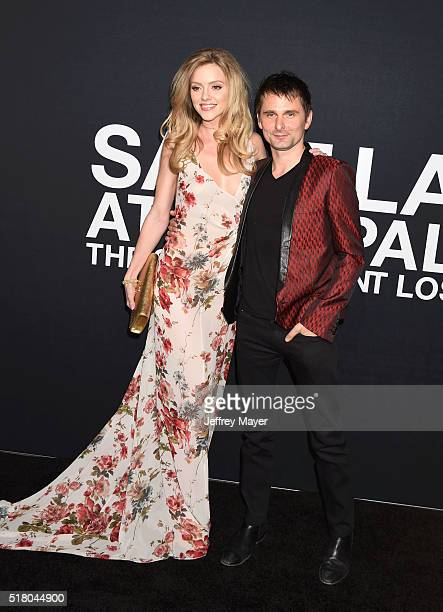 Model Elle Evans and musician Matt Bellamy attend the Saint Laurent show at The Hollywood Palladium on February 10 2016 in Los Angeles California