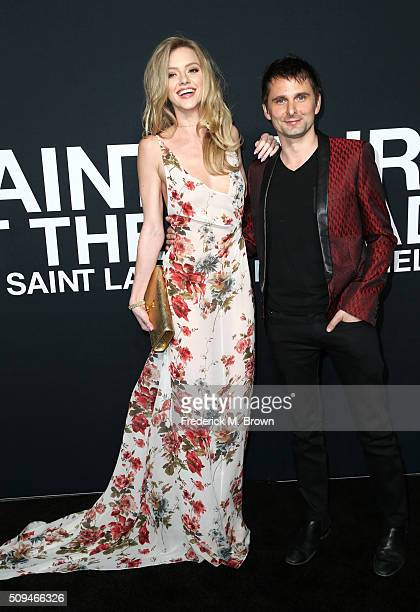 Model Elle Evans and recording artist Matt Bellamy of Muse arrive at the Saint Laurent show at The Hollywood Palladium on February 10 2016 in Los...