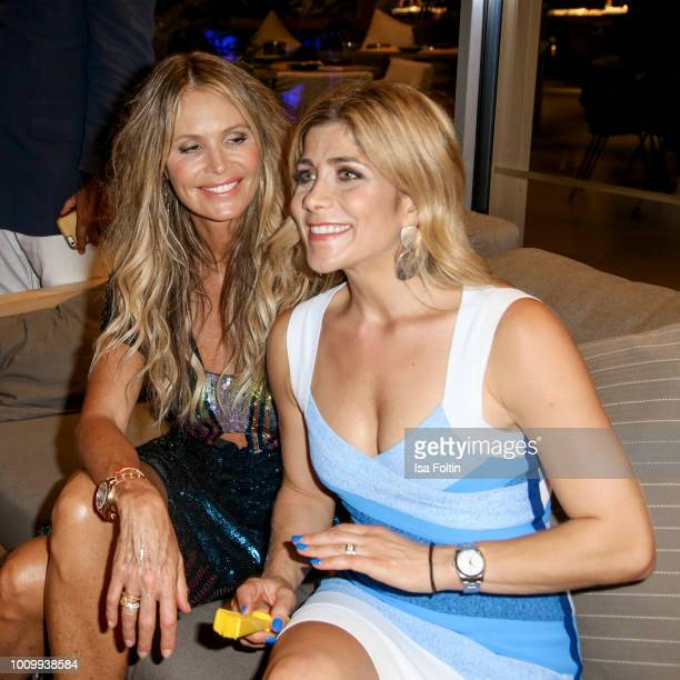 Model Elle Macpherson and presenter Panagiota Petridou attends the Remus Lifestyle Night on August 2, 2018 in Palma de Mallorca, Spain.