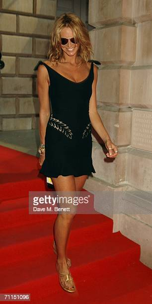 Model Elle Macpherson leaves the champagne reception launching the world's oldest and largest open art competition and exhibition at the Royal...