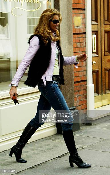 Model Elle Macpherson shops for clothes in Bonpoint on February 25 2004 in London