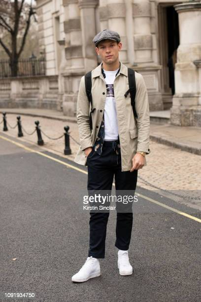 Model Elliott Reeder wears a River Island hat Blood Brother T shirt Brave Soul jacket Nike trainers during London Fashion Week Men's January 2019 on...