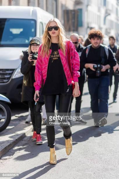 Model Elsa Hosh wearing a pink jacket black Chanel tshirt outside Trussardi during Milan Fashion Week Fall/Winter 2017/18 on February 26 2017 in...