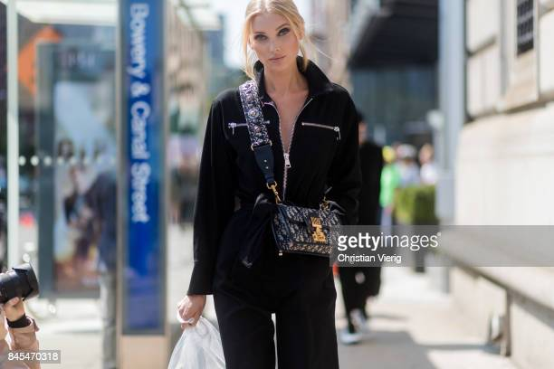 Model Elsa Hosk wearing a black overall seen in the streets of Manhattan outside Public School during New York Fashion Week on September 10 2017 in...