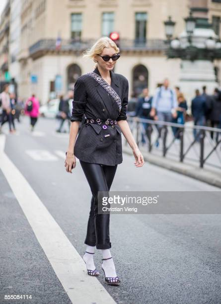 Model Elsa Hosk wearing blazer cropped pants white socks heels is seen outside Balmain during Paris Fashion Week Spring/Summer 2018 on September 28...