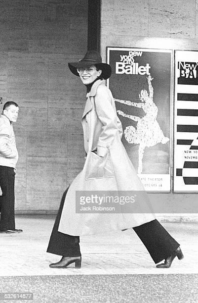 Model Elsa Peretti walks on a street, New York, 20th century.