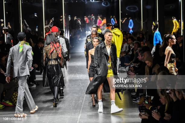 US model Emily Ratajkowski and models present creations for fashion house Versace during the Men's Fall/Winter 2019/20 fashion shows in Milan on...