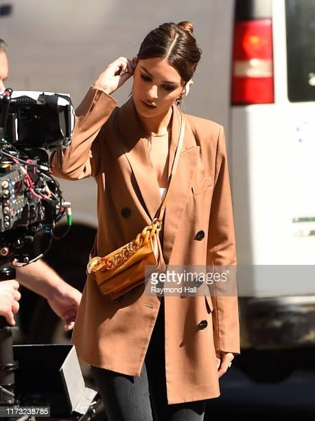 Model Emily Ratajkowski is seen at a photo shoot for Beats Headphones in Soho on October 2 2019 in New York City