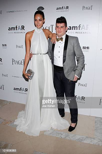 Model Emina Cunmulaj and designer Eli Mizrahi attend the 2010 amfAR New York Inspiration Gala at The New York Public Library on June 3 2010 in New...