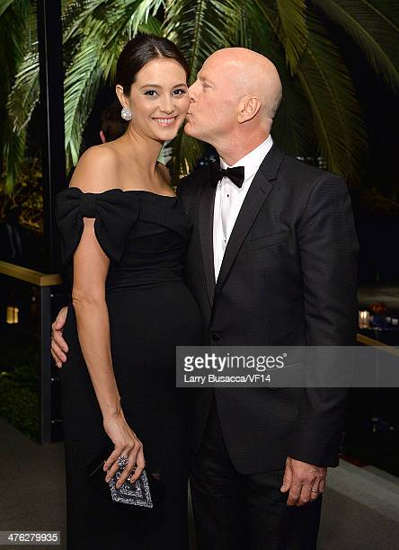 Model Emma Heming and actor Bruce Willis attend the 2014 Vanity Fair Oscar Party Viewing Dinner Hosted By Graydon Carter on March 2 2014 in West...