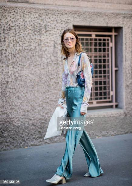 Model Emmy Rappe wearing pastel satin pants Dior bag blouse with floral print is seen outside Acne Studios during Paris Fashion Week Haute Couture...