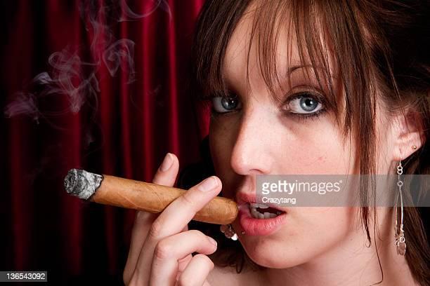 model enjoying a cigar - beautiful women smoking cigars stock photos and pictures