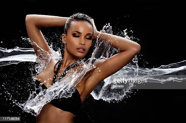 model enjoying splashing at her body water