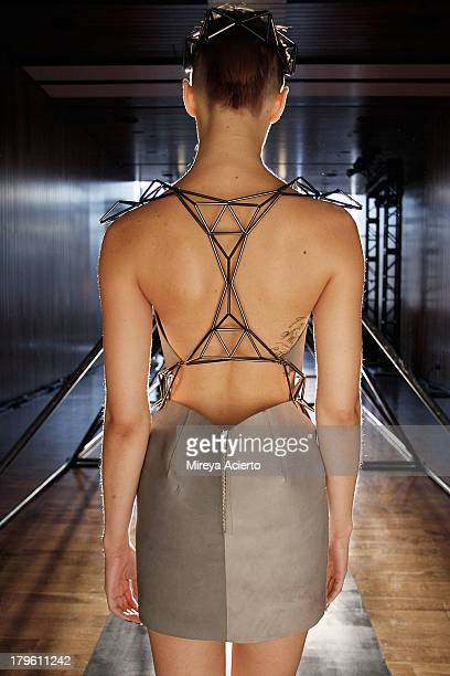 A model enters runway exposing back at the Titania Inglis presentation during MercedesBenz Fashion Week Spring 2014 at The Standard Hotel High Line...