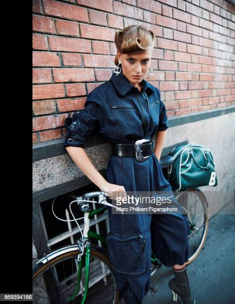 Model Erika Palkovicova poses at a fashion shoot for Madame Figaro on July 21 2017 in Paris France Jumpsuit and boots earrings belt bag PUBLISHED...
