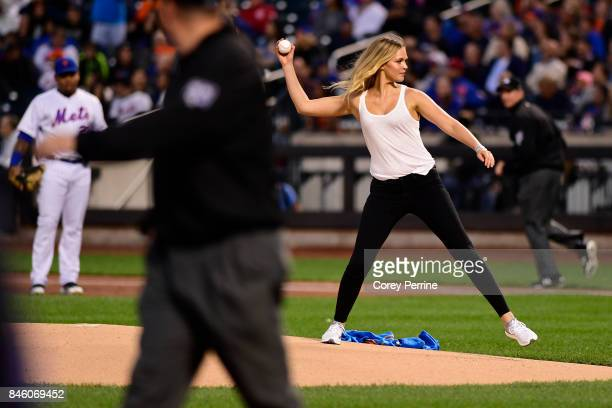 Model Erin Heatherton throws out the ceremonial first pitch as the New York Mets host the Cincinnati Reds at Citi Field on September 9 2017 in the...