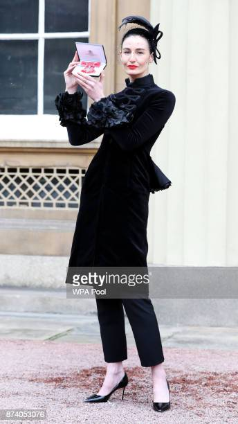 Model Erin O'Connor poses after she was awarded an MBE from Queen Elizabeth II at Buckingham Palace on November 14 2017 in London United Kingdom