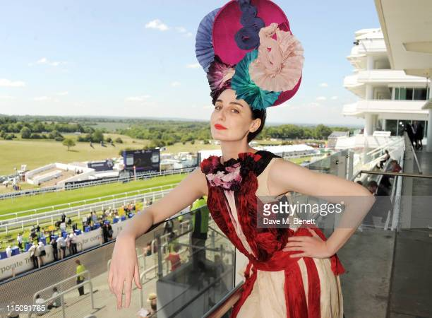 Model Erin O'Connor poses wearing a hat by Louis Mariette and a bespoke dress by Felicity Brown created for this occasion attends Investec Ladies Day...