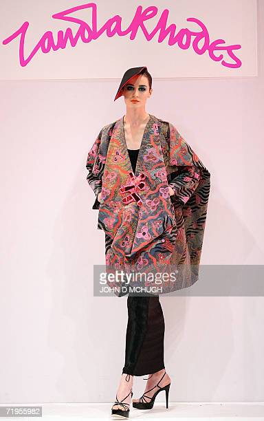 Model Erin O'Connor presents a creation from the SpringSummer 2007 collection of British Designer Zandra Rhodes 20 September 2006 at London Fashion...