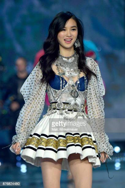 Model Estelle Chen walks the runway during the 2017 Victoria's Secret Fashion Show In Shanghai at MercedesBenz Arena on November 20 2017 in Shanghai...