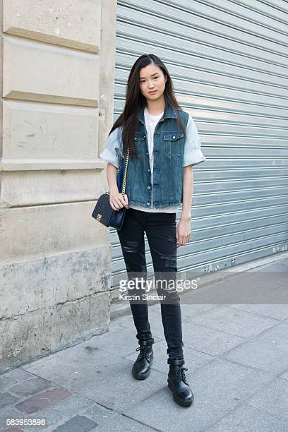 Model Estelle Chen wears Page jeans MM6 jacket Balenciaga boots and a Chanel bag day 4 of Paris Haute Couture Fashion Week Autumn/Winter 2016 on July...