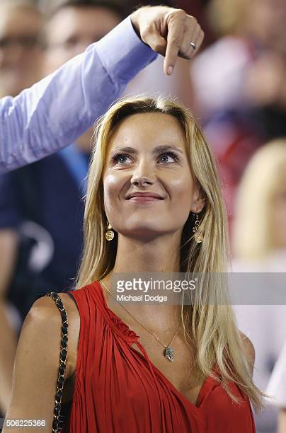 Model Ester Satarova celebrates after husband Tomas Berdych of the Czech Republic wins in his third round match against Nick Krygios of Australia...