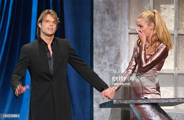 Model Esther Canadas presents the award for the arts to Ricky Martin at the Hispanic Heritage Awards Ceremony