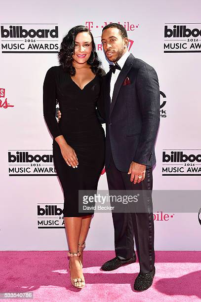 Model Eudoxie Mbouguiengue and cohost Ludacris attend the 2016 Billboard Music Awards at TMobile Arena on May 22 2016 in Las Vegas Nevada