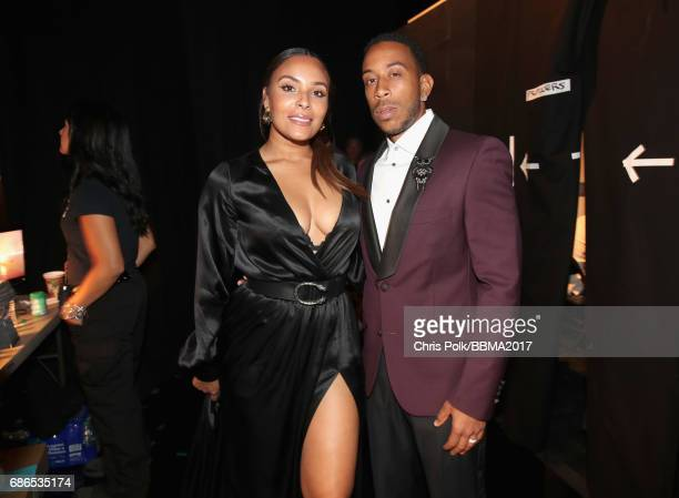 Model Eudoxie Mbouguiengue and host Ludacris attend the 2017 Billboard Music Awards at TMobile Arena on May 21 2017 in Las Vegas Nevada