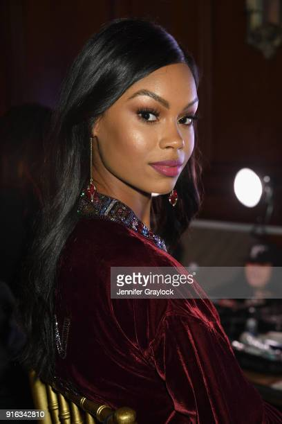 Model Eugena Washington prepares backstage during the NYFW Sherri Hill Runway Show on February 9 2018 in New York City