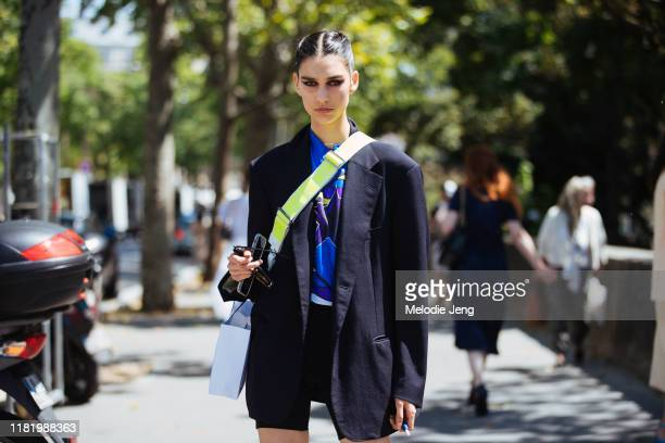 Model Eugenia Dubinova wears an oversized black blazer after the Elie Saab show during Couture Fashion Week Fall/Winter 2019 on July 03, 2019 in...