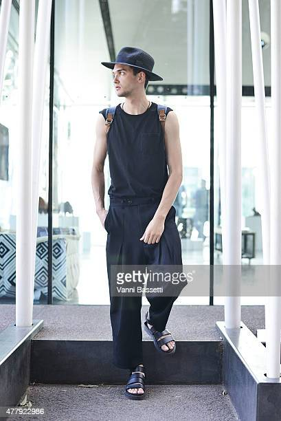 Model Eugeny Atomanchyk poses before Jil Sander show on June 20 2015 in Milan Italy