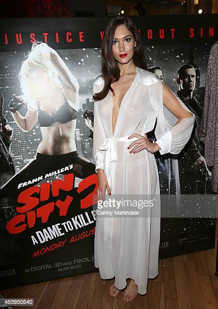"""Model Eva Bohatova attends a photocall recreation of the """"Sin City 2"""" movie poster at Coco De Mer on August 22, 2014 in London, England."""
