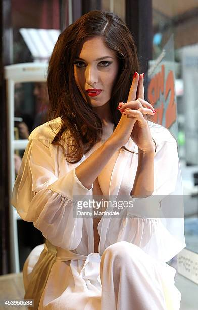 """Model Eva Bohatova poses at a photocall recreation of the """"Sin City 2"""" movie poster at Coco De Mer on August 22, 2014 in London, England."""
