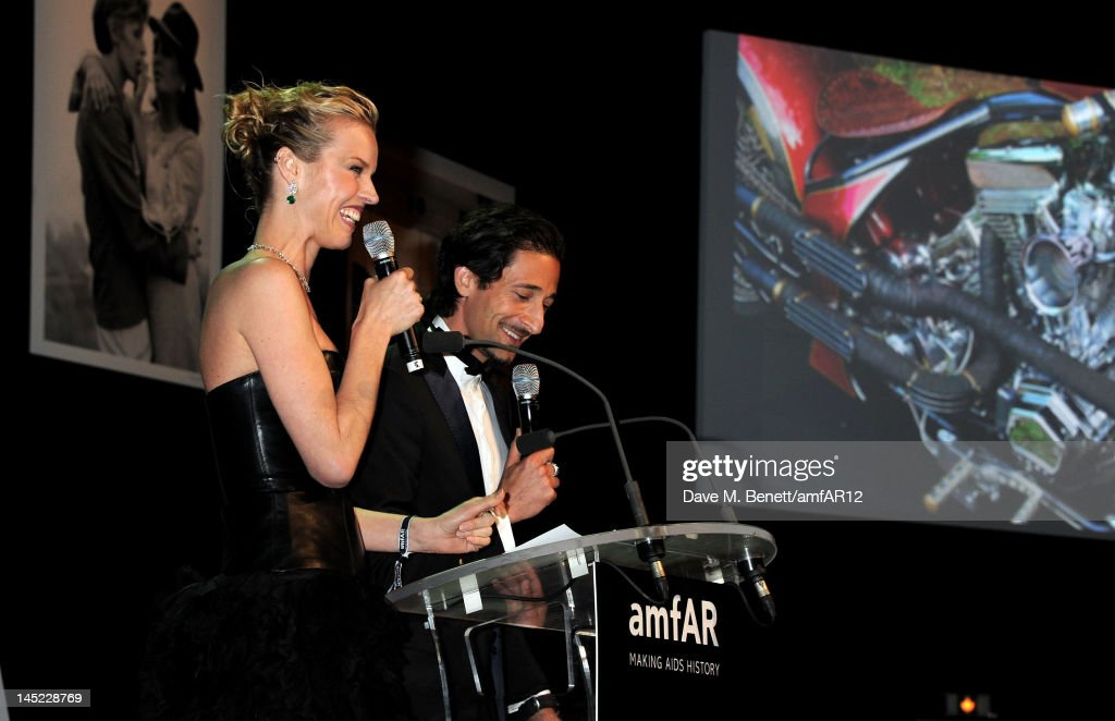 Model Eva Herzigova (L) and actor Adrien Brody attend the 2012 amfAR's Cinema Against AIDS during the 65th Annual Cannes Film Festival at Hotel Du Cap on May 24, 2012 in Cap D'Antibes, France.