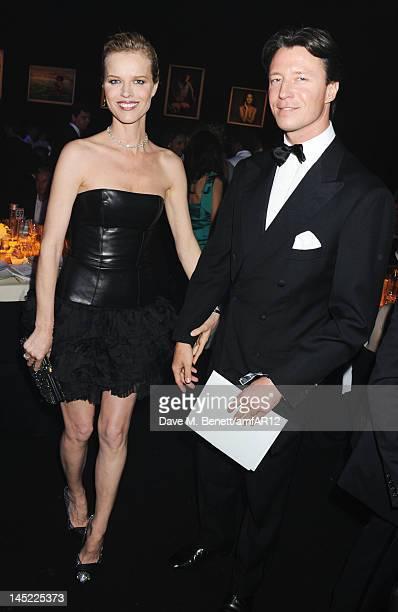 Model Eva Herzigova and Gregorio Marsiaj attend the 2012 amfAR's Cinema Against AIDS during the 65th Annual Cannes Film Festival at Hotel Du Cap on...