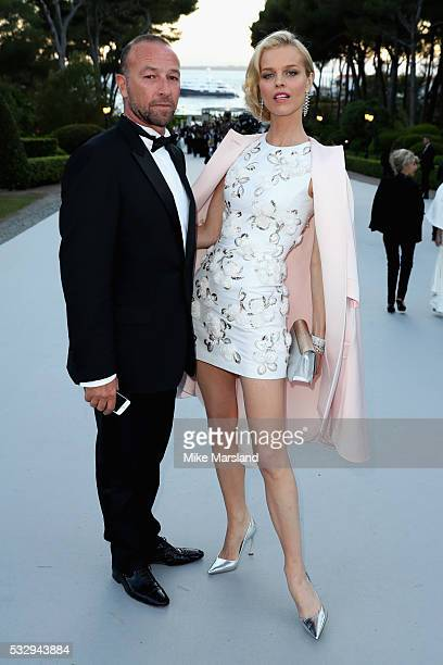 Model Eva Herzigova and guest attend the amfAR's 23rd Cinema Against AIDS Gala at Hotel du CapEdenRoc on May 19 2016 in Cap d'Antibes France