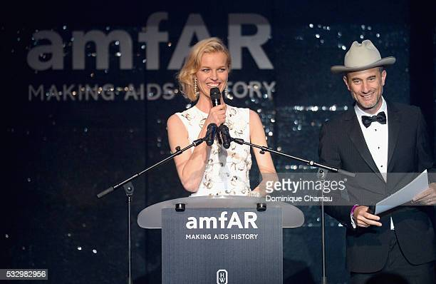 Model Eva Herzigova and producer and president of AAB Productions Andy Boose appear on stage at the amfAR's 23rd Cinema Against AIDS Gala at Hotel du...