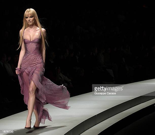 Model Eva Herzigova wears an outfit from the Versace Autumn/Winter 20032004 collection during Milan Fashion Week March 4 2003 in Milan