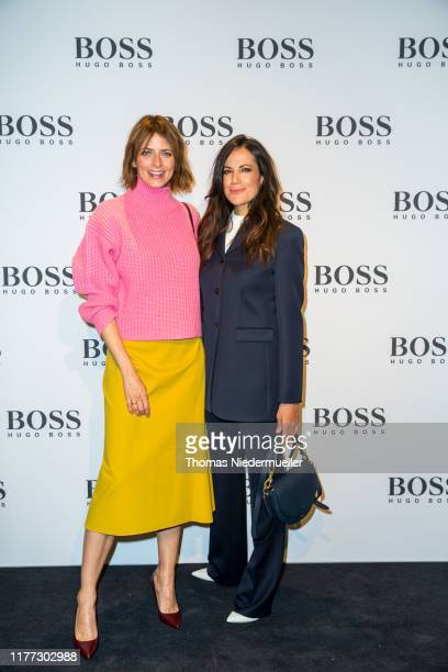 Model Eva Padberg and actress Bettina Zimmermann attend the HUGO BOSS Outlet opening at OutletCity on September 26 2019 in Metzingen Germany