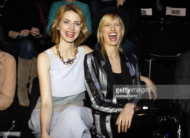Model Eva Padberg and Karolina Kurkova attend the Kilian Kerner Autumn/Winter 2012 fashion show during MercedesBenz Fashion Week Berlin at...