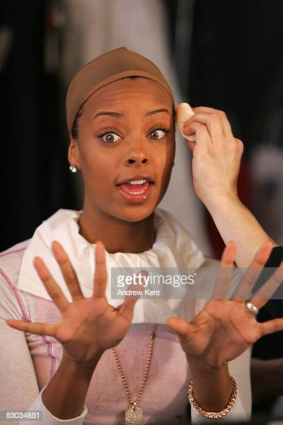 Model Eva Pigford winner of America's Next Top Model working behind the scenes during a photo shoot for CoverGirl's new mascara on February 18 2005...
