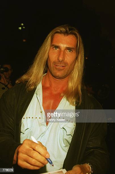 Model Fabio signs autographs outside Largo's Restaurant August 28 2000 in Santa Monica CA Comedian Rodney Dangerfield renewed his vows with his wife...